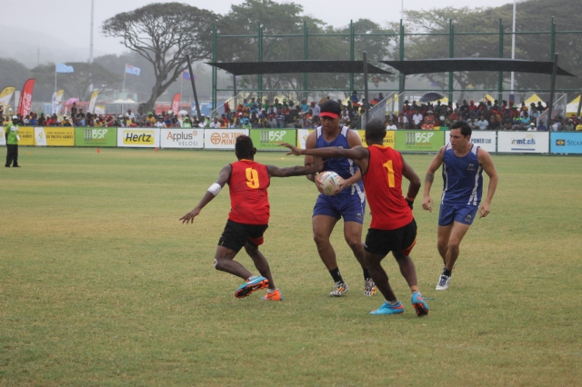 PNG and Samoa fought out a 7-7 draw in the mixed touch footy round-robin stage. Photo by Leslie Omaro.