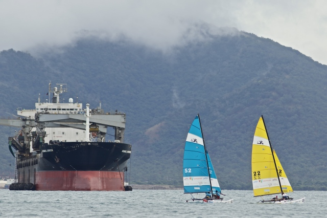Ships shapes: Normal shipping traffic in Port Moresby Harbour had a great view of POM 2015 sailing competition. Photo by Susie Pini.