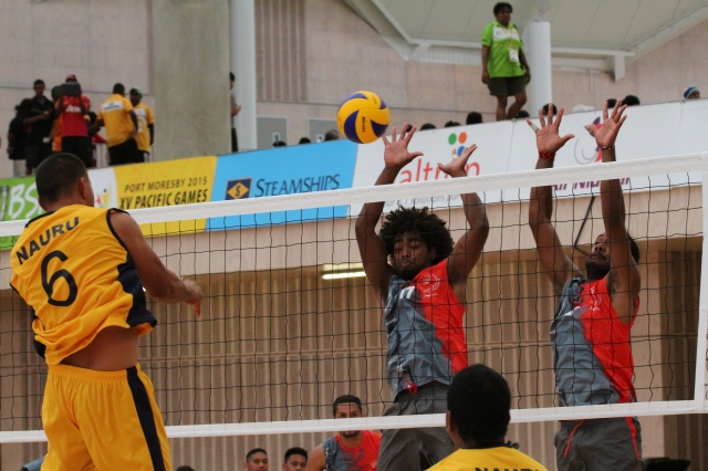 Silas Dame (6) spikes in Nauru's men's volleyball 3-0 loss against New Caledonia. Photo by Vere Freeman.