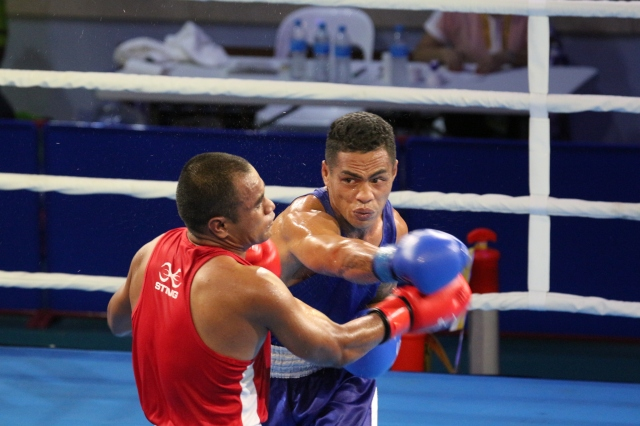 Bell ringer: The second day of men's boxing saw fights across four weight categories. Photo by Vere Freeman.