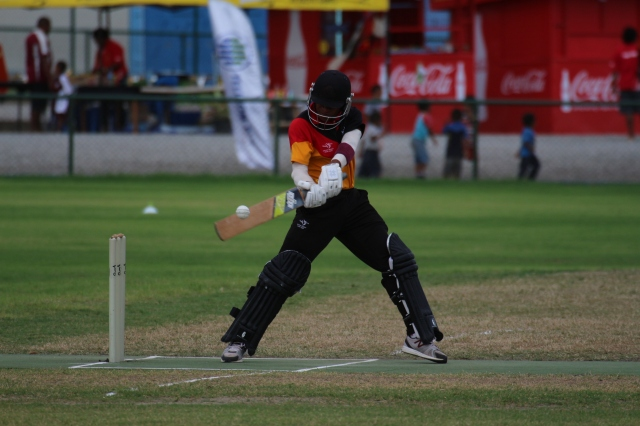 Cutting loose: A PNG player plays a wild cut shot at Bisini Grounds on Thursday. Photo by Vere Freeman.