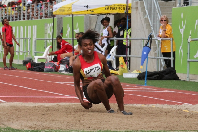Rellie Kaputin (PNG) leaps for gold in the women's long jump. Photo by Freeman Vere.