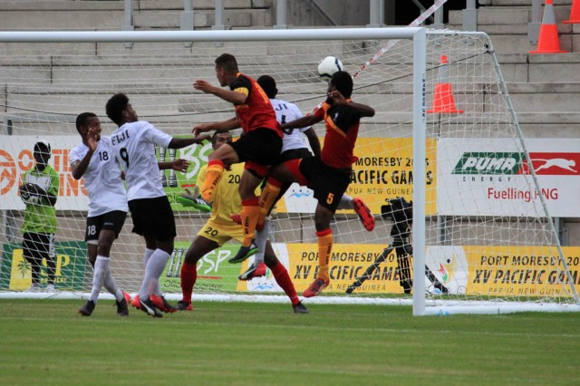 Alwin Komolong's header secured bronze for Papua New Guinea in men's soccer. Photo by Tanya Zeriga-Alone.