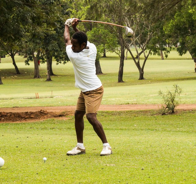 Vanuatu's Clement Mansale at the top of his swing on day three at Royal Port Moresby Golf Club. Photo by Eliud Uwasenko