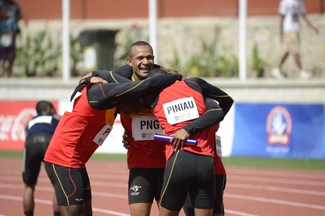PNG's men's 4x100m relay team celebrate their gold medal-winning performance at BSP Stadium on Friday. Photo by Roan Paul.