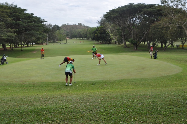 Action from the women's golf tournament at the Port Moresby 2015 Pacific Games on Friday. Photo by Michael Boeo.