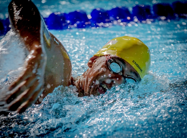 Churn it up: A swimmer takes a breath during the men's 400m freestyle at BSP Arena pool on Wednesday. Photo by Dave Buller.