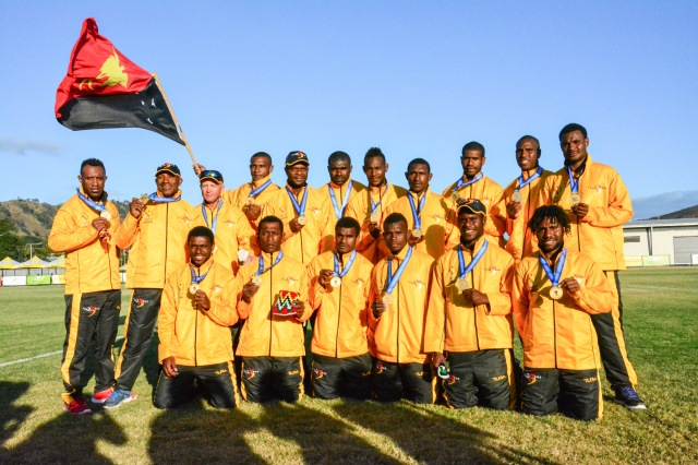 PNG men's touch footy team with their gold medals. Photo: Chris Lam.