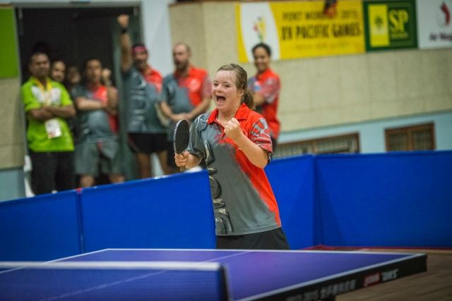 Fifteen year old Delphine Andre (NCL) celebrates her win in the  women's standing para-table tennis event. Photo by Olga Fontanellaz.