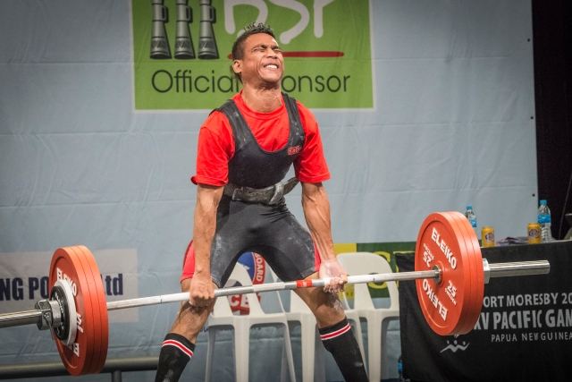 Take the pain: A powerlifter strains under the weight of his dead lift. Photo by Olga Fontanellaz.