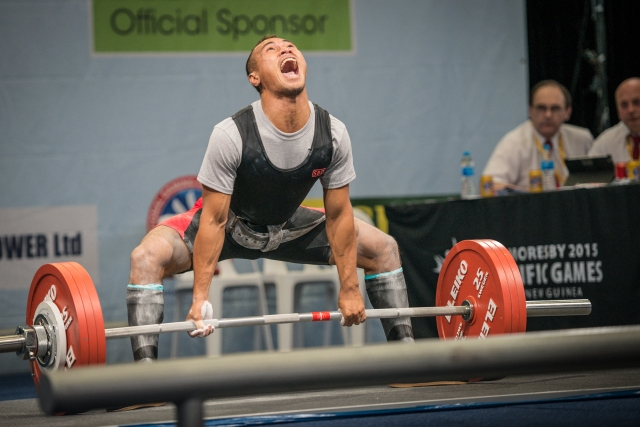 Roar power: A powerlifter puts everything in to his dead lift attempt. Photo by Olga Fontanellaz.
