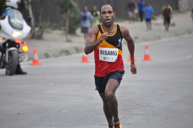 Kupsy Bisamo (PNG) won gold in the men's half marathon on Saturday. Photo by Michael Boeo.