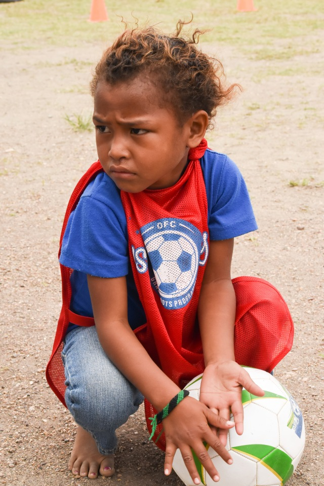 Little league: A little one looks forward to the UNICEF Just Play programme. Photo by Fiona Munday.