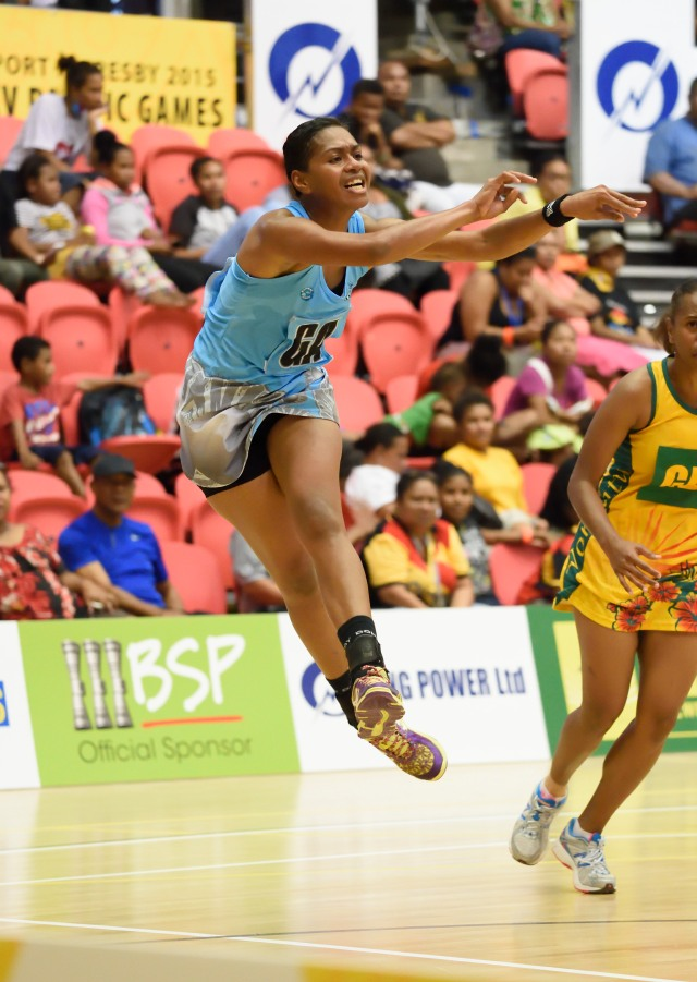 A Fiji player executing a pass during the women's netball game against Vanuatu. Photo by Isaac Tauno
