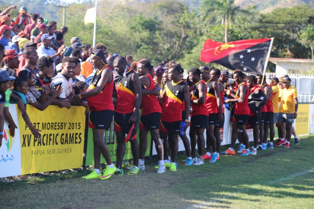 PNG men's touch footy team celebrate with the crowd after winning gold. Photo by Jason Wuri.