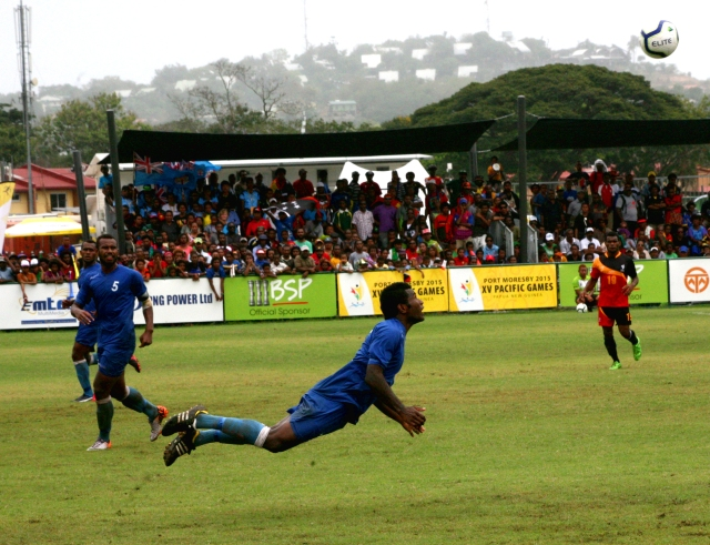 A Fiji defender clears the ball with his head in the semifinal against PNG. The final is to be played on Sunday. Photo by Risha Hess.