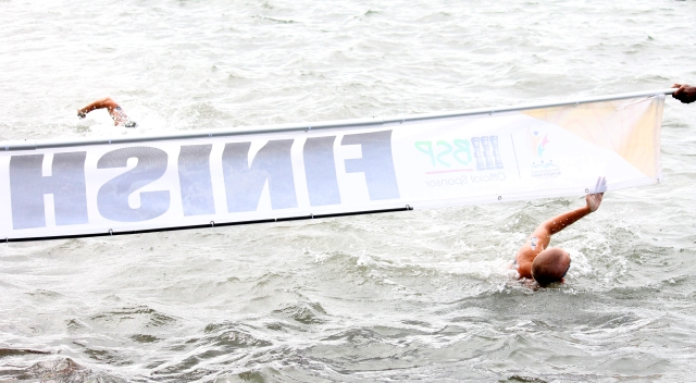New Caledonia's Thibaut Mary wins men's open water swimming gold. Photo by Vere Freeman