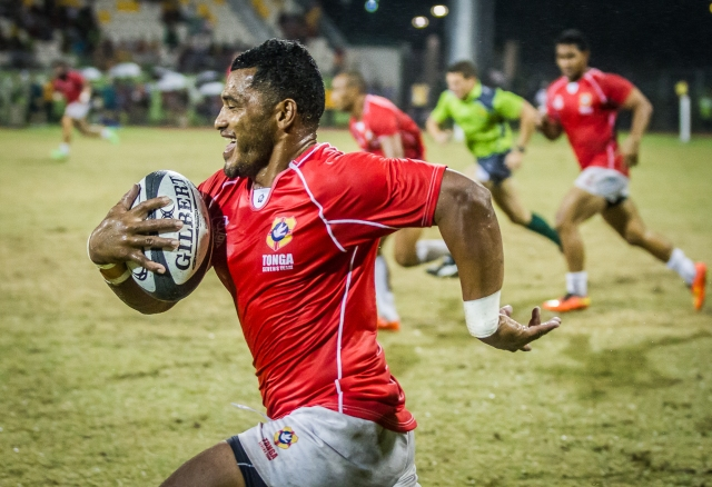 In smiles of space: A Tongan player makes a break down the left side of the pitch in the bronze medal game. Photo by Dave Buller.