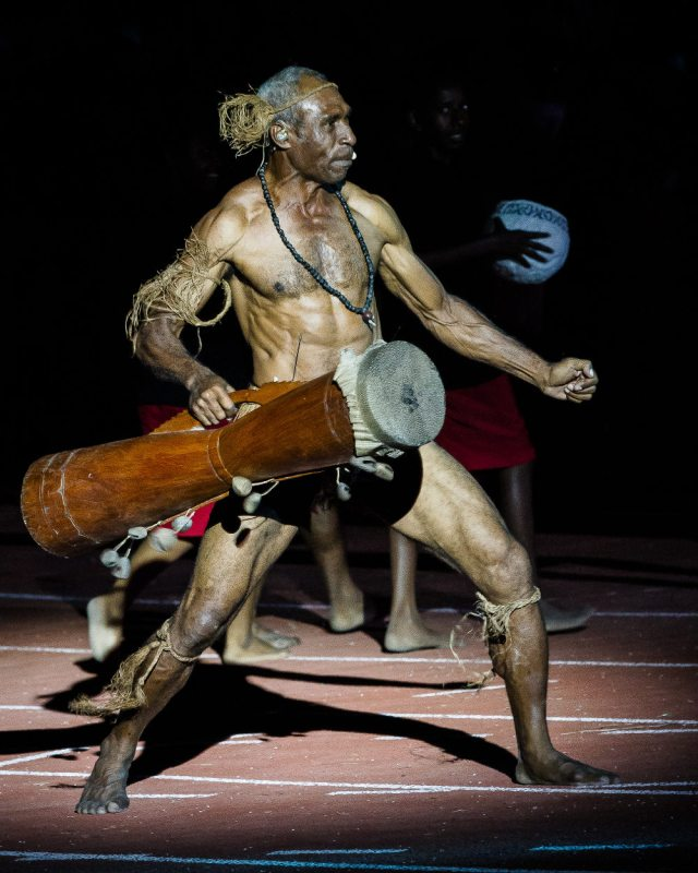Drum solo: A performer strikes a pose at the opening ceremony. Photo by Dave Buller.