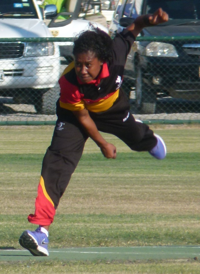 Tanya Ruma (PNG) puts everything into a delivery during Papua New Guinea's win against Cook Islands on Monday. Photo: Rex Kia