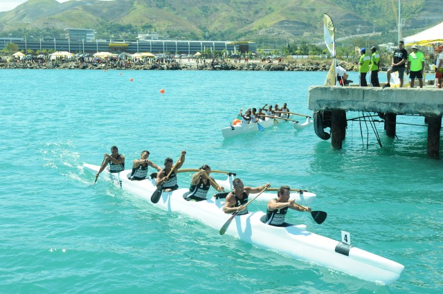 Va'a paddlers bringing it home on the Port Moresby harbour course. Photo: Roan Paul