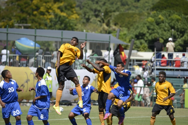 Too short: This impending header likely ended up in the back of the net as Vanuatu put 46 past Federated States of Micronesia in men's soccer. Photo by Roan Paul.
