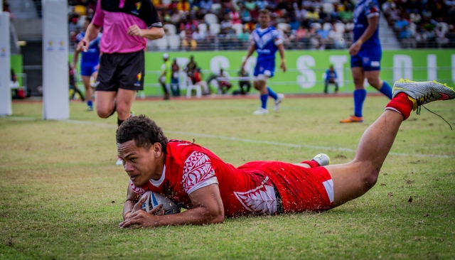 Slip and try-d: A Tonga rugby league 9s player slides in for a try against Samoa on Saturday. Photo by Dave Buller.