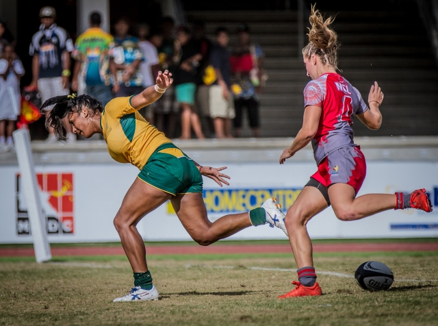 Mahalia Murphy scores a try in Australia's 22-5 win against New Caledonia. Photo by Dave Buller