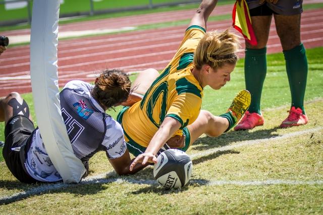 Brooke Anderon scores in the corner despite the attention of Akosita Ravato in Australia's 26-7 win against Fiji. Photo by Dave Buller.