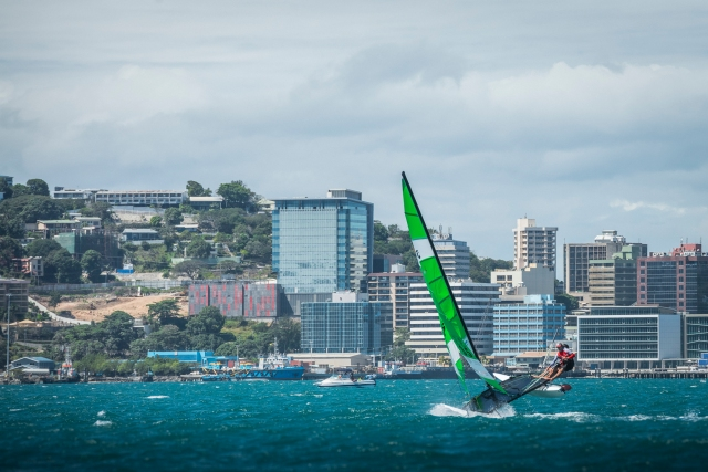 Hulled on for dear life: Multi-hulled hobie cat sailors ride Port Moresby Harbour's breeze towards the city.