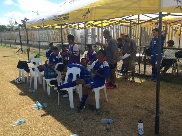 Federated States of Micronesia coach Stan Foster with his team during their 46-0 loss to Vanuatu. Photo: Kevin Darling.