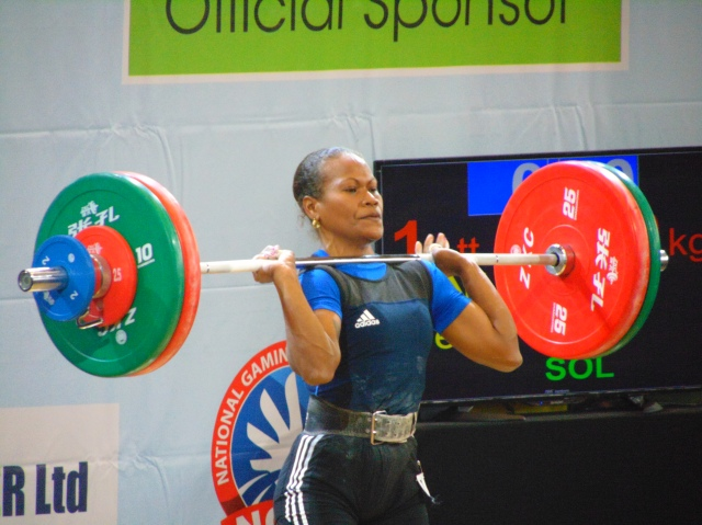 Jenly Tegu Wini (SOL) wins women's 58kg gold in weightlifting. photo: Stephen Kwaragu