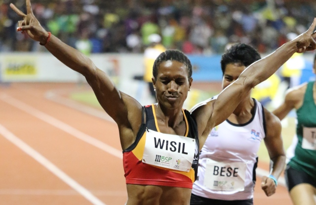 Toea Wisil thrilled the crowd at BSP Stadium with a gold medal-winning performance in the women's 100m. Photo by Susie Pini.